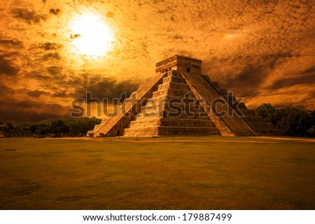 El Castillo (The Kukulkan Temple) of Chichen Itza complex at sunset, mayan pyramid in Yucatan, Mexico - stock photo