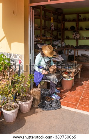 EL CERCADO, LA GOMERA, SPAIN - JANUARY 28. A potter at work in front of the workshop in the well known pottery village El Cercado on the Canary Island La Gomera on January 28, 2016