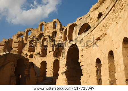 El Djem, Amphitheatre at sunny day. Arches of roman biggest amphitheater, at sunset, in El Djam, Tunisia - stock photo