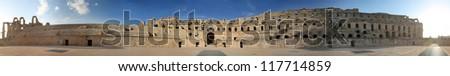 El Djem Amphitheatre long panorama. Long panorama of central podium and the whole roman amphitheater in El Djam, Tunisia - stock photo