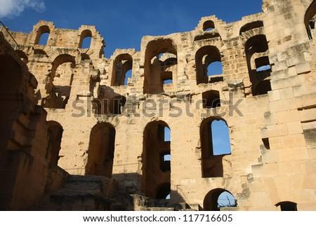 El Djem Amphitheatre ruinous walls. Arches of roman biggest amphitheater in africa in El Djam, Tunisia - stock photo