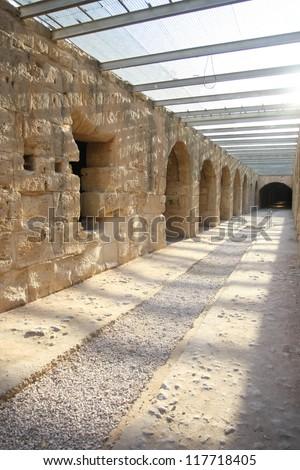 El Djem Amphitheatre, underground corridors. Underground corridors of roman biggest amphitheater in africa in El Djam, Tunisia - stock photo