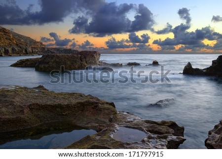 El Golfo beach in a cloudy sunset in Lanzarote, Canary islands - stock photo