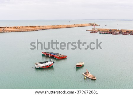 EL JADIDA, MOROCCO, APRIL 5, 2015:fishing boats in  the old port in a historic city on the Atlantic coast of Morocco, in the province of El Jadida. - stock photo