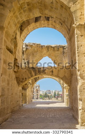 EL JEM, TUNISIA - SEPTEMBER 1, 2015: The numerous stone arches in Roman amphitheatre provide stability of the ancient walls, on September 1, in El Jem. - stock photo
