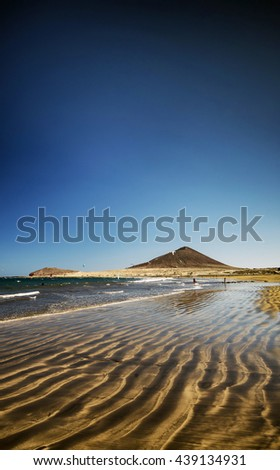el medano surfing beach and montana roja landmark  in south tenerife spain - stock photo