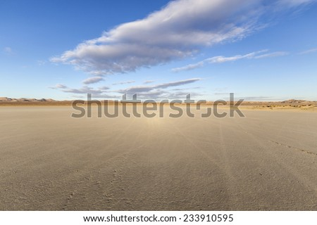 El Mirage dry lake bed in California's Mojave desert. - stock photo