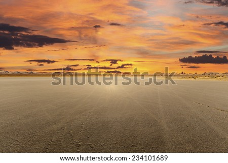 El Mirage dry lake with sunset in California's Mojave desert - stock photo