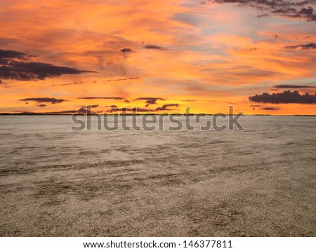 El Mirage dry lake with sunset sky in California's Mojave Desert. - stock photo