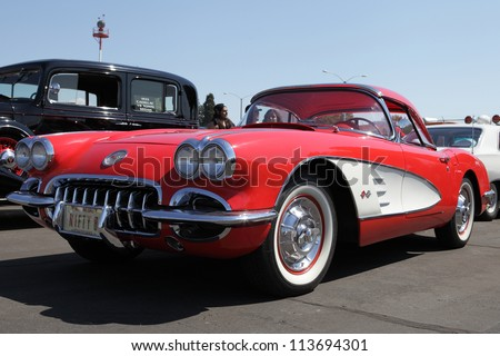 EL MONTE, CALIFORNIA, USA - SEPTEMBER 23:A variety of rare vintage cars on display at the El Monte Airshow on September 23, 2012.  1958 Chevrolet Corvette Roadster with 290 HP V-8 engine. - stock photo