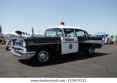 EL MONTE, CALIFORNIA, USA - SEPTEMBER 23:A wide variety of rare vintage aircraft and cars on display at the El Monte Airshow on September 23, 2012.  A vintage El Monte police vehicle. - stock photo