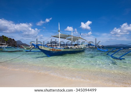 EL NIDO, PHILIPPINES - JANUARY 31, 2014 : Boats waiting for tourists to travel between the islands. El Nido is one of the top tourist destinations in the world.