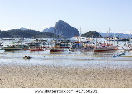 El NIDO, PHILIPPINES - JANUARY. 1: The port and the boats in the fishing village of El Nido JANUARY. 1, 2016 in El Nido Philippines.