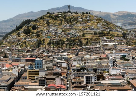 El Panecillo is a hill located in the middle west of Quito, Ecuador. A monument to the Virgin Mary is located on top of El Panecillo and is visible from most of the city of Quito. - stock photo