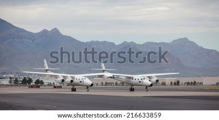 EL PASO - SEPTEMBER 11.  Virgin Galactic landed its White Knight Two spaceship at  El Paso International Airport for refueling on its way to Spaceport America on September 11, 2014 at El Paso, Texas. - stock photo