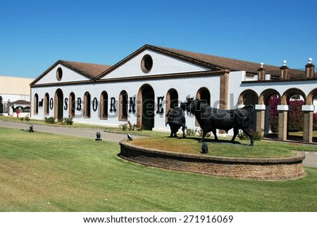 EL PUERTO DE SANTA MARIA, SPAIN - AUGUST 20, 2008 - View of the Osborne Bodega with a bull statue in the foreground, El Puerto de Santa Maria, Andalusia, Spain, Western Europe, August 20, 2008. - stock photo