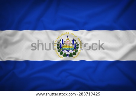 El Salvador flag on the fabric texture background,Vintage style - stock photo