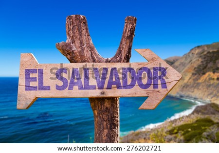 El Salvador wooden sign with coast background - stock photo