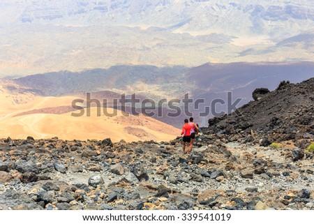 El Teide, Tenerife, June 06, 2015: Unidentified people runs from the top of El Teide Volcano, Tenerife, Spain - stock photo