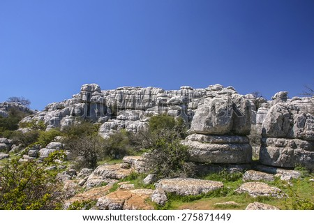 El Torcal de Antequera is a nature reserve in the Sierra del Torcal mountain range, southern Spain.It is known for its unusual landforms, and is one of the most impressive karst landscapes in Europe   - stock photo