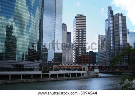 El train crossing bridge and Chicago skyline - stock photo