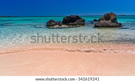 Elafonisi (Island of Deer) is like paradise on earth, and possessess a wonderful beach with pink coral sand and turquoise water, Crete, Greece - stock photo