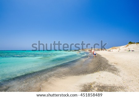 Elafonissi Lagoon, Crete Island, Greece. Elafonisi beach is one of the best beaches of Europe. This part of the beach is with black and white sand. - stock photo