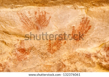 Elands Cave bushman paintings - palms. Shot in Elands Bay, West Coast, South Africa. - stock photo