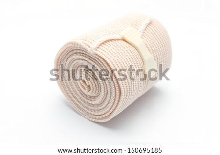 Elastic ACE compression bandage warp unwrapped, isolated - stock photo
