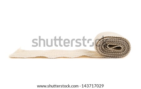 Elastic ACE compression bandage warp unwrapped, isolated over white background, side view - stock photo