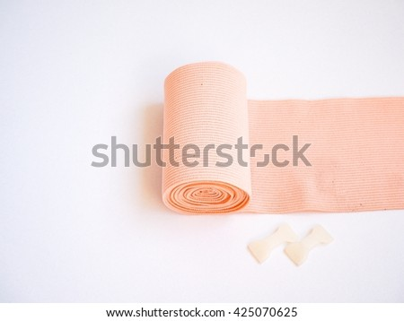 Elastic bandage and clip isolated on white background - stock photo