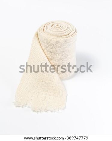 Elastic bandage on a white background - stock photo