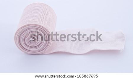 Elastic bandage on white background - stock photo