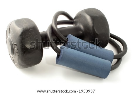 elastic exercise band  and hand weight for strength training - stock photo