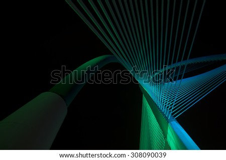 Elasticity of the bridge's string and the futuristic architecture (Image has certain noise and soft focus ) - stock photo