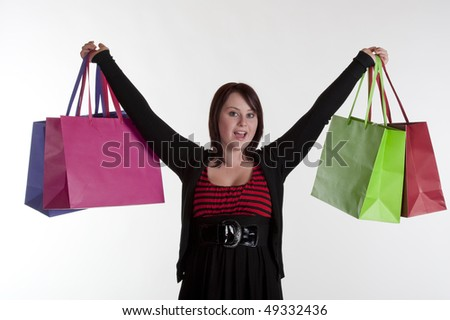elated teenage girl after shopping spree against white background - stock photo