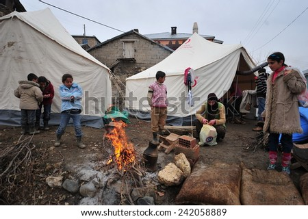 ELAZIG, TURKEY - MARCH 09:  Houses ruined during the earthquake of Elazig. Earthquake victims are living in tents on March 09, 2010 in Elazig, Turkey.  - stock photo
