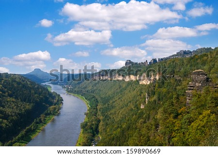 elbe river and saechsische schweiz sandstone mountains in germany - stock photo