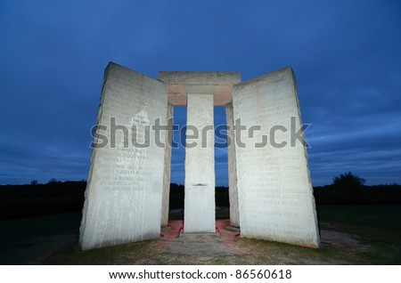 "ELBERT, GEORGIA - OCTOBER 12: The Georgia Guidestones, occasionally referred to as ""American Stonehenge"" October 12, 2011 in Elbert, GA. The inscription is of 10 principles in 8 different langauges. - stock photo"