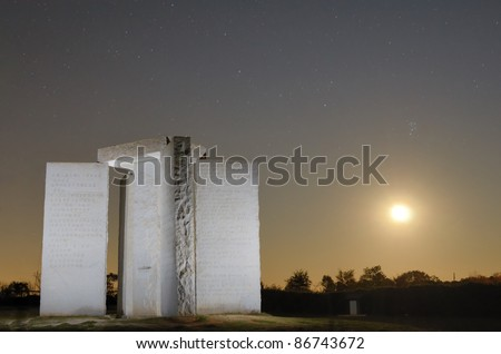 "ELBERT, GEORGIA - OCTOBER 15: The Georgia Guidestones, occasionally referred to as ""American Stonehendge"" October 15, 2011 in Elbert, GA. The inscription is 10 principles in 8 different langauges. - stock photo"
