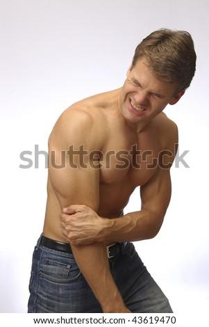 Elbow pain - stock photo