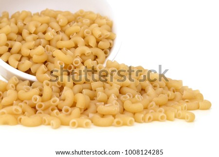 elbow pasta fall down on white