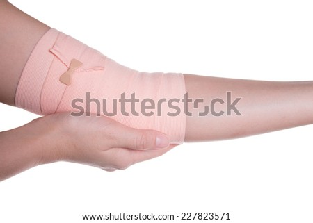 Elbow tied elastic bandage on a white background
