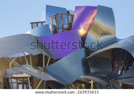 ELCIEGO, SPAIN - MAY 9: The modern winery of Marques de Riscal on May 9, 2014 in Elciego, Basque Country, Spain. This modern winery, designed by Frank Gehry, was built in 2007. - stock photo
