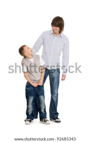 Elder and younger brothers, happily smiling. Isolated on white. - stock photo