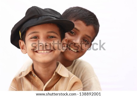 Elder brother holding younger - stock photo
