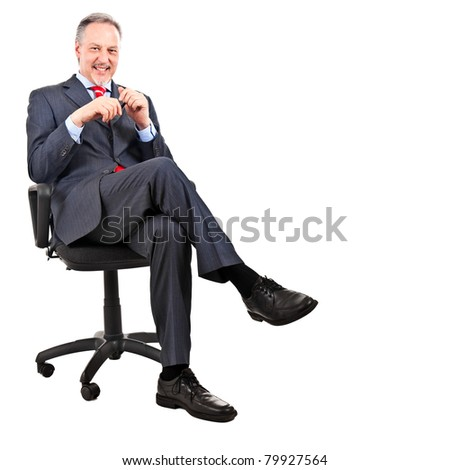Elder businessman sitting on a chair, isolated on white - stock photo