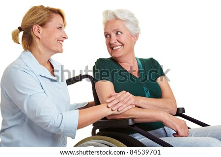 Elder care for disabled senior woman in wheelchair - stock photo