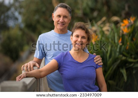 Elder couple taking care of each other - stock photo