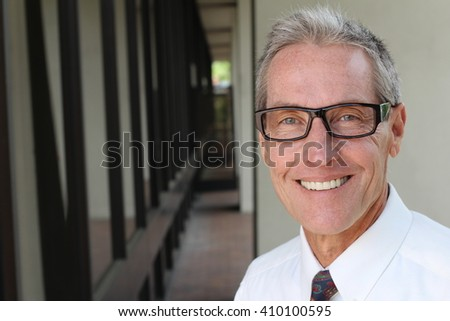 Elder male with a perfect smile and copy space on the left - stock photo